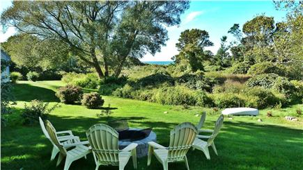 Brewster Cape Cod vacation rental - View of Cape Cod Bay and the fire pit.