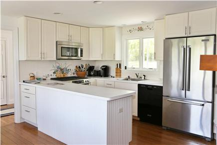 Brewster Cape Cod vacation rental - Kitchen with the dining area to the left.