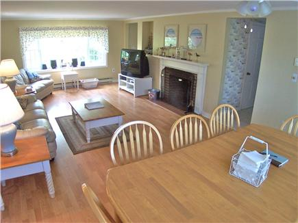 Brewster Cape Cod vacation rental - Large dining table occupies one end of the open living space
