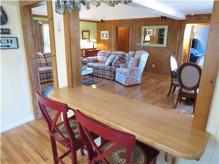 Brewster Cape Cod vacation rental - Handy island seating and pass-through to the dining area beyond