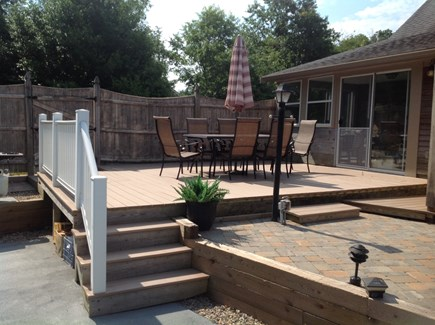 Dennis Cape Cod vacation rental - Sunny deck overlooking pool.