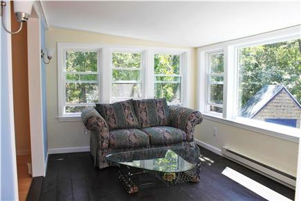 Brewster Cape Cod vacation rental - Sunroom overlooking back yard with slider to deck