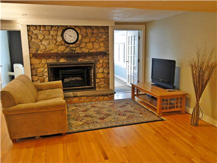 Pocasset, Bourne, Cape Cod Cape Cod vacation rental - Lower level living room with TV, fireplace