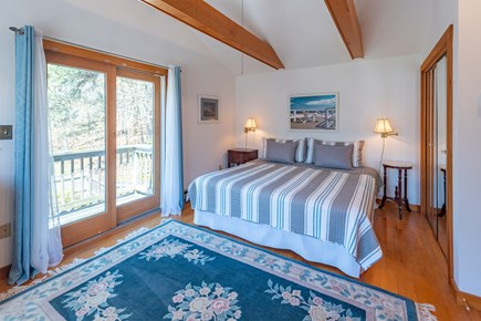 Chatham Cape Cod vacation rental - Master bedroom upstairs with small balcony overlooking the deck.