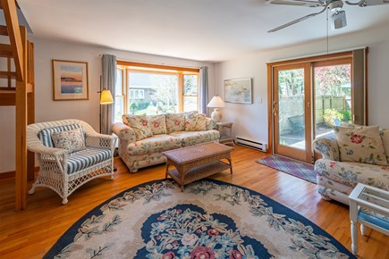 Chatham Cape Cod vacation rental - Living room with slider to the deck and patio.