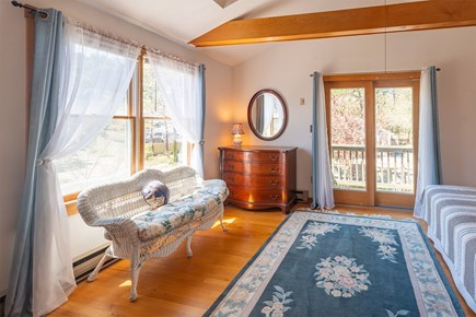Chatham Cape Cod vacation rental - Master bedroom upstairs with slider to balcony overlooking patio.