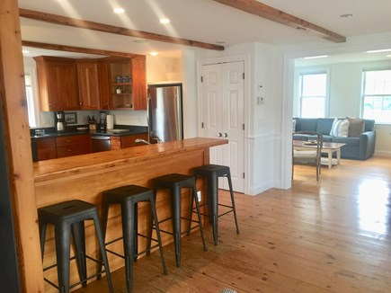 Harwich Port Cape Cod vacation rental - Chef's kitchen and bar with additional bar sink