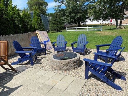 Harwich Port Cape Cod vacation rental - Great patio & yard with cornhole and firepit.