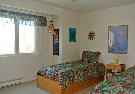 Brewster Cape Cod vacation rental - Twin size beds with storage and TV.