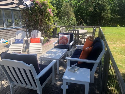Eastham Cape Cod vacation rental - Main deck seating area with dining table in rear