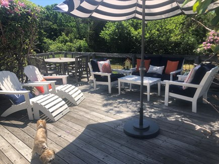 Eastham Cape Cod vacation rental - Main deck seating area--with dining table in rear