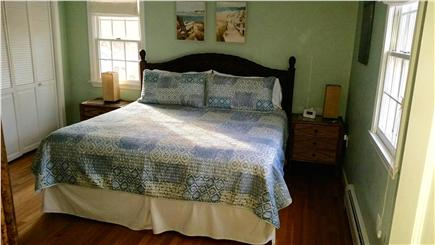 Harwich Cape Cod vacation rental - King Master bedroom w/ adjacent 1/2 bath, window a/c