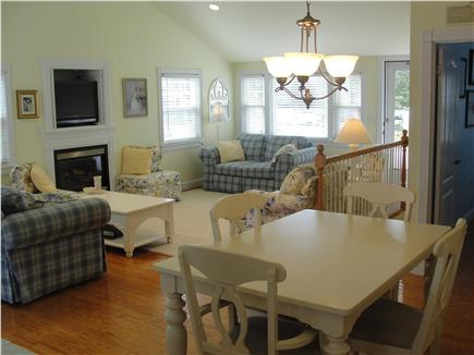 Falmouth-Maravista Cape Cod vacation rental - Living room & dining area w/cathedral ceilings