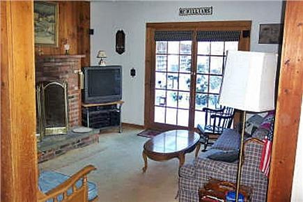 Dennisport Cape Cod vacation rental - Fireplaced Living Room with glass doors to deck