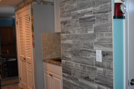 Dennis Cape Cod vacation rental - New kitchen cabinets, stone wall, stainless steel refrig.
