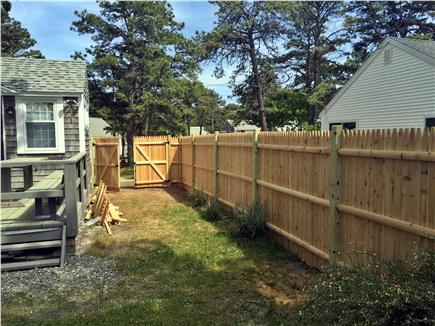 Dennisport Cape Cod vacation rental - Side yard with new privacyfence