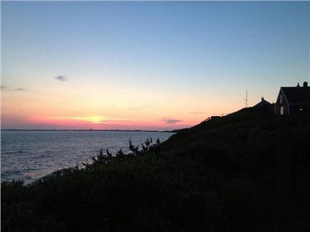 North Truro Cape Cod vacation rental - Summer sun setting over Provincetown, seen from deck.