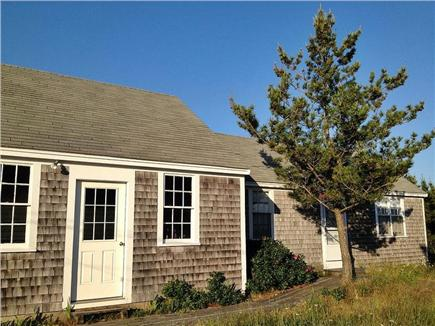North Truro Cape Cod vacation rental - The ''bunk house'' is behind pine tree, door shown is garage.