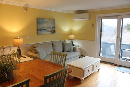 Hyannis Cape Cod vacation rental - Seating are off of Kitchen with TV & leads out to the patio