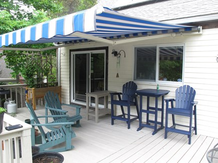 South Orleans Cape Cod vacation rental - Upper deck seating, grill, awning, views of gardens, pond