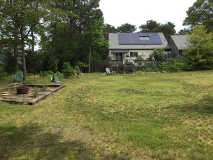 South Orleans Cape Cod vacation rental - Backyard view of solar panels