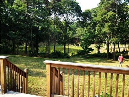 South Orleans Cape Cod vacation rental - Backyard and pond view from lower deck