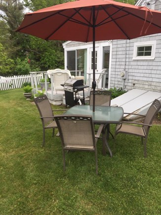 West Dennis Cape Cod vacation rental - Furniture on deck, gas grill and patio furniture in yard