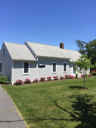 West Dennis Cape Cod vacation rental - Front of house with nice yard and beautiful roses