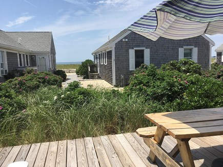 Truro Cape Cod vacation rental - View of deck and boardwalk to private beach, from the doorway.