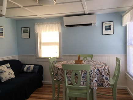 Truro Cape Cod vacation rental - Living/ dining space. AC unit on wall