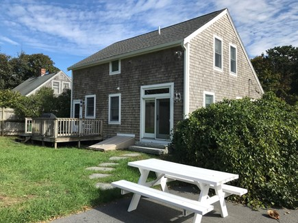 Harwichport Cape Cod vacation rental - Back Yard/ Picnic table/Driveway