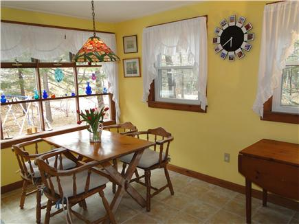 Brewster Cape Cod vacation rental - Sunny dining area with bay window facing yard