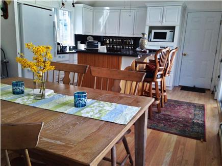Eastham Cape Cod vacation rental - Sunny dining room view into fully equipped skylit kitchen