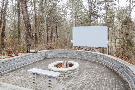 Chatham Cape Cod vacation rental - Large stone firepit with an AWESOME outdoor movie theater