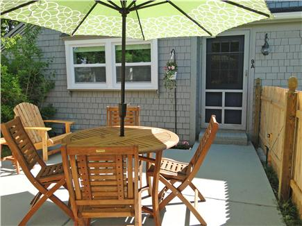 Hyannis  Cape Cod vacation rental - Sunny spot outside for dining & relaxing with distant water view