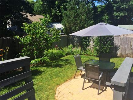 West Yarmouth Cape Cod vacation rental - New stone patio, flower beds and lawn games in the shed.