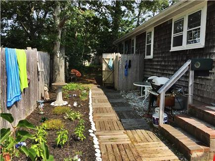 Dennisport Cape Cod vacation rental - Backyard- Grill, secluded back patio, out door shower