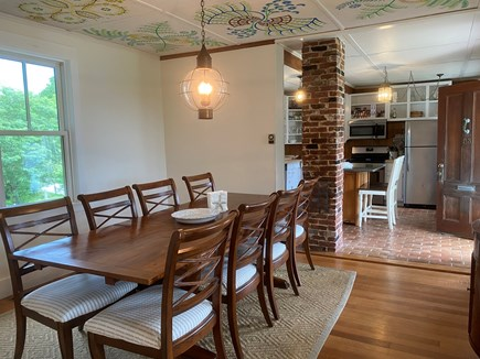 Woods Hole, Close to town and beach Cape Cod vacation rental - 96 inch table in window flanked dining opening on to the kitchen