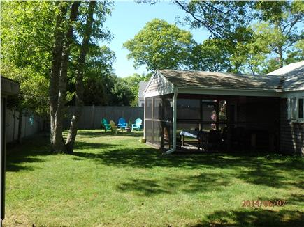 Hyannis, Craigville Cape Cod vacation rental - Large fenced-in private yard, shed with beach games, shade trees