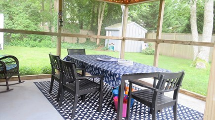 Hyannis, Craigville Cape Cod vacation rental - Attached screened patio with lighting and fan, seating for 8+