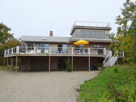 Eastham Cape Cod vacation rental - Front of house showing the second floor deck and roof deck
