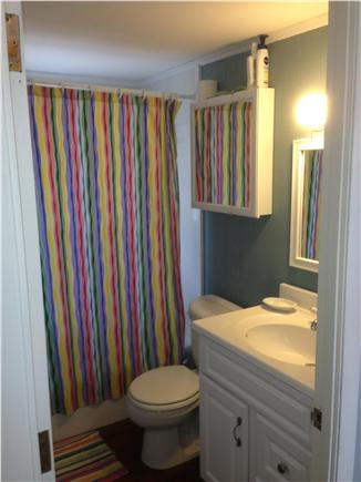 Falmouth Cape Cod vacation rental - Upstairs bathroom with tub and shower.