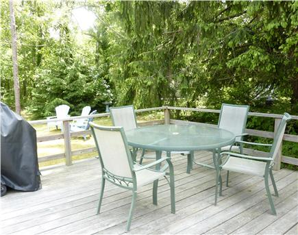 West Harwich Cape Cod vacation rental - Large backyard with deck, gas grill, dining table, outdoor shower