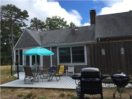 Eastham Cape Cod vacation rental - Private back patio with grills, seating and outdoor shower.