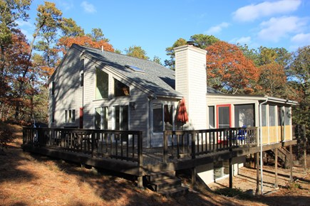 Wellfleet Cape Cod vacation rental - Large deck with grill and screened porch, peaceful wooded area