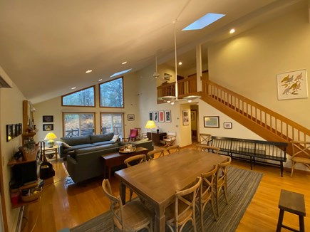 Wellfleet Cape Cod vacation rental - Main floor living & dining area, staircase to 2nd floor