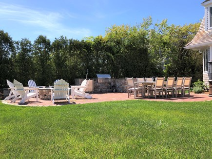 Harwich Port Cape Cod vacation rental - Outdoor dining room and fire pit