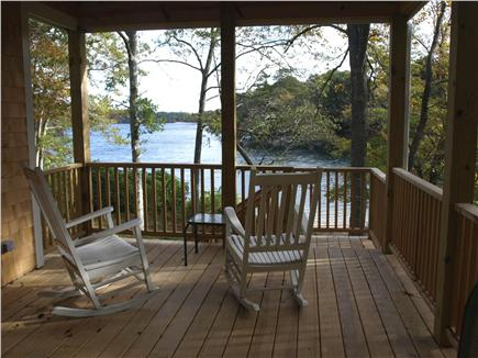 East Falmouth Cape Cod vacation rental - Deck off upper level, steps down to grass and beach