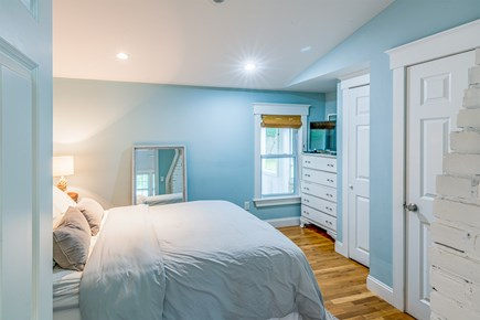 West Yarmouth Cape Cod vacation rental - Master Bedroom with Queen Bed, TV, and Half Bath
