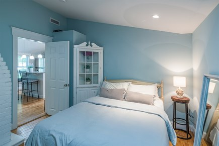 West Yarmouth Cape Cod vacation rental - Master Bedroom with Queen Bed, TV and Half Bath